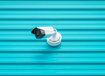 Surveillance video camera isolated on blue