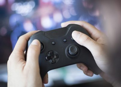 video-game-player-holding-control_adobe